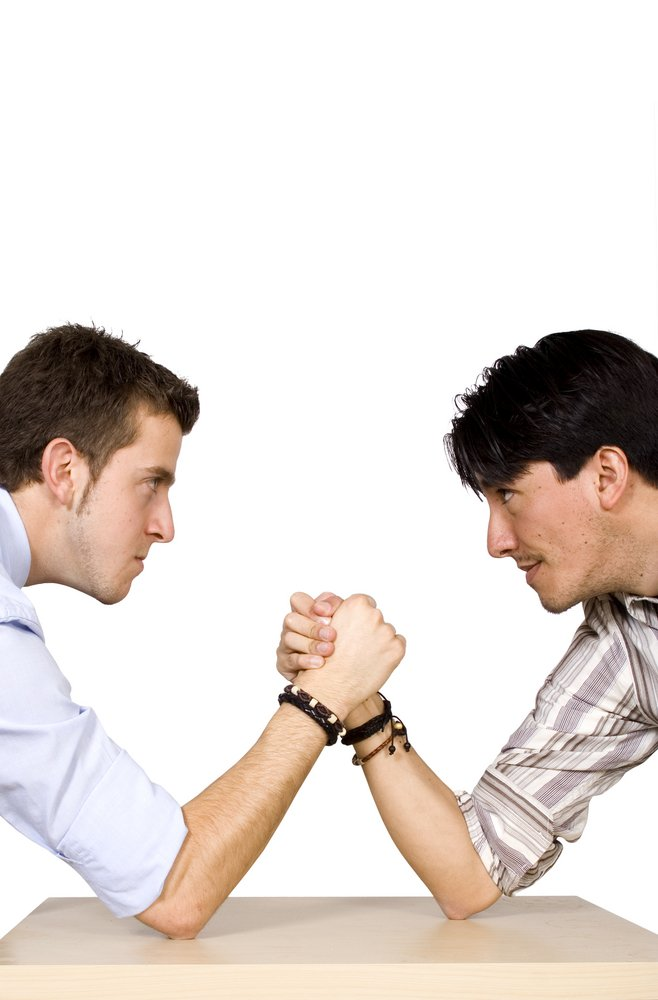 business arm wrestling between two men from different racial backgrounds